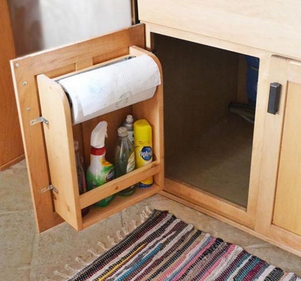 Attach brackets to the inside of the cabinet door to store toilet paper rolls, house cleaning supplies, tools, or any other bottom cabinet items.