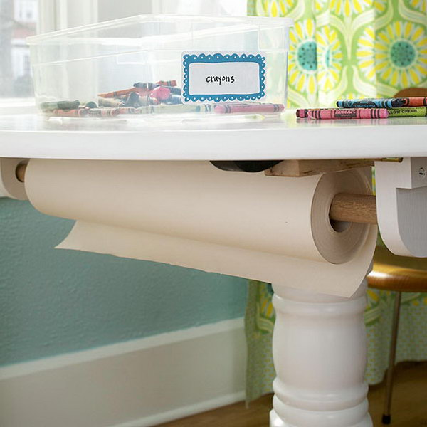 Screw a holder to the bottom of the table for storing a spool of wrapping paper.