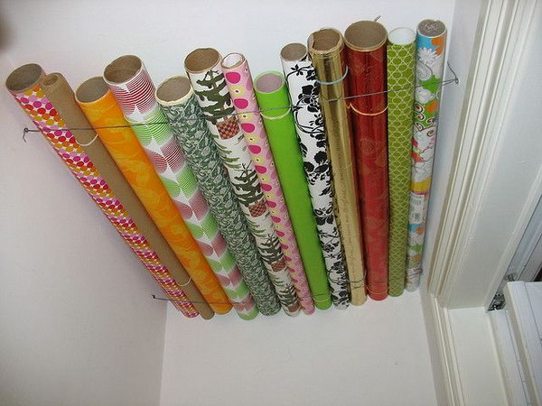 Store your wrapping paper with wasted ceiling space in a closet.