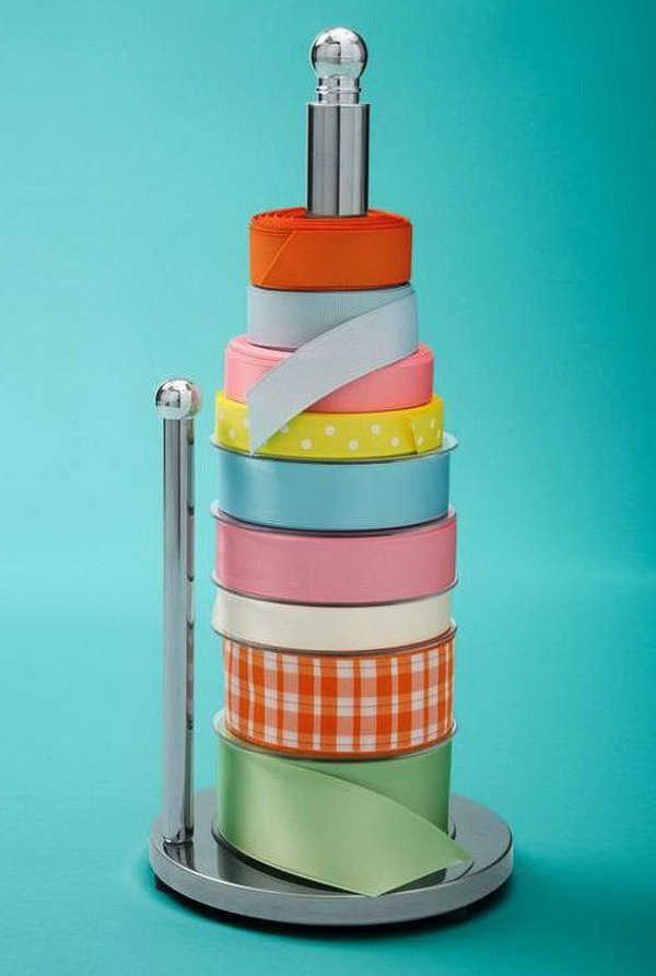 Use a paper towel holder to keep your spools of ribbon organized and easy to get to.