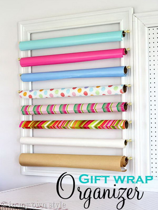 Make a gift wrap organizer with frames and curtain rods. It looks like a piece of art itself hanging on the wall.
