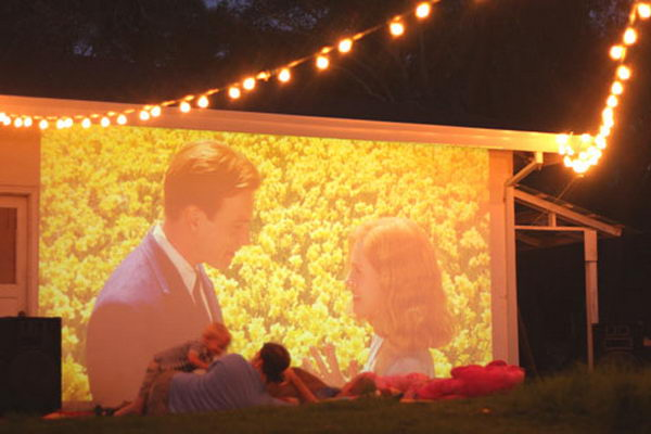 Outdoor Backyard Movie Theater. Interesting things to do out there in your backyard. So simple and cheap to make, and you could play them with your kids or family anytime.