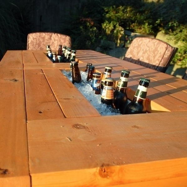 Diy Patio Table with Built in Beer Coolers. Interesting things to do out there in your backyard. So simple and cheap to make, and you could play them with your kids or family anytime.