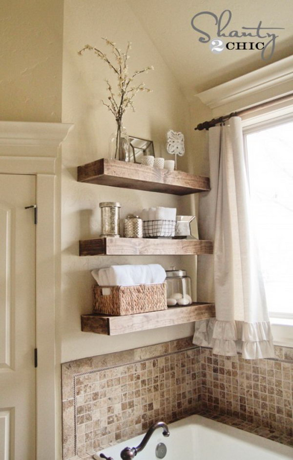 DIY Floating Shelves Above Bathtub. Organize your bath stuff with these DIY rustic floating shelves. They are chic, sleek, and much easier to DIY than they look.