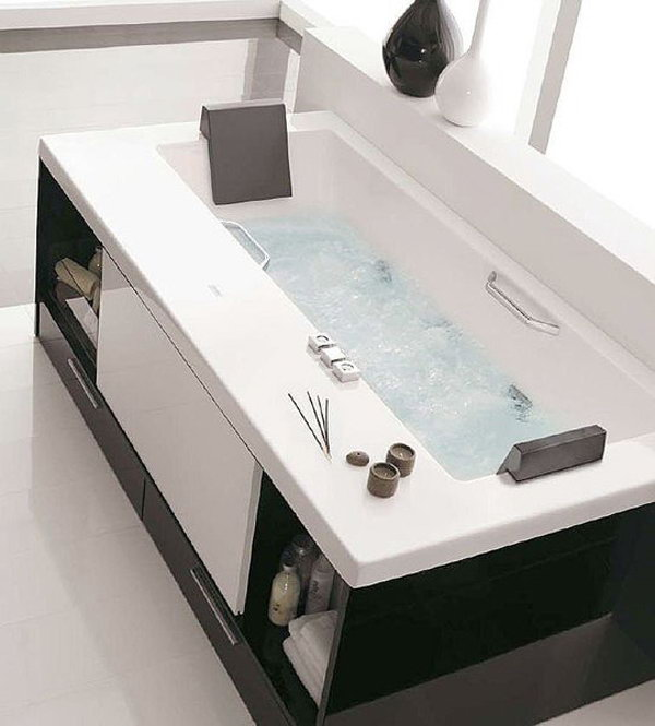 Drawers and Shelves Around the Bathtub. A clever idea which allows for much towel storage while taking virtually no extra space.