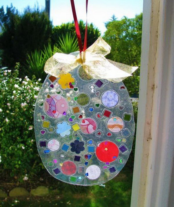 Easter egg Suncatcher. It's an easy Easter craft that the children can make using sticky contact, bits of scrap paper, pieces of foil, shapes and sequins.