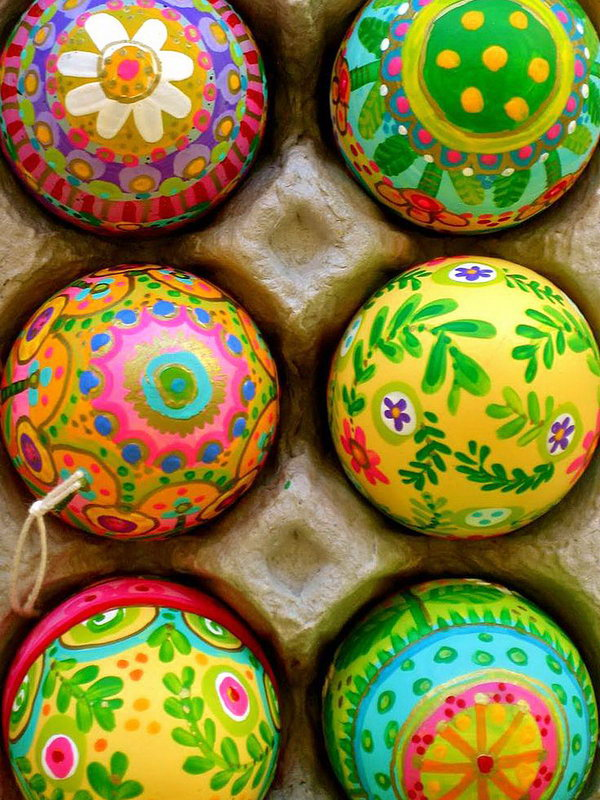 Paint Easter Eggs from bottom to top with spring patterns.