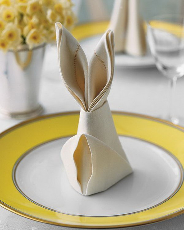 Bunny Fold for Napkins. These Easter rabbit shaped napkins are an easy way to dress up napkins on your Easter table which only require a few simple folds.