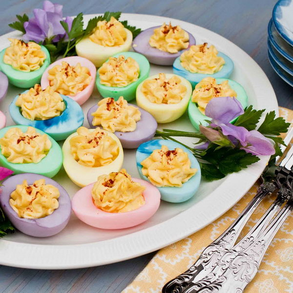 Delicious and Colorful Easter eggs. It's an easy way to twist your deviled egg recipe for Easter. These rainbow colored deviled eggs are an amazing healthy alternative to traditional deviled eggs.