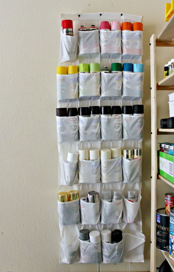Garage Storage with Shoe Organizer. A great idea to recycle your old things and keep the spray paints from spreading out over shelves and bins.