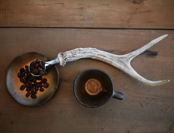 Antler Coffee Scoop. Cool gift for coffee lover friends. It allows them to enjoy their coffee in a new and interesting way.