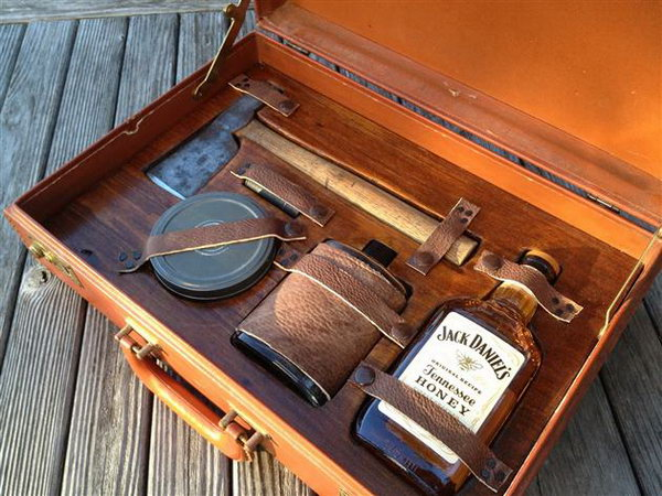 Groomsmen Survival Kit. As gentleman, there are a few items we need to keep ourselves alive. This kit features everything you would need in an emergency including a flask, whiskey, hatchet, matches, and a handful of other goods packed into a vintage briefcase.
