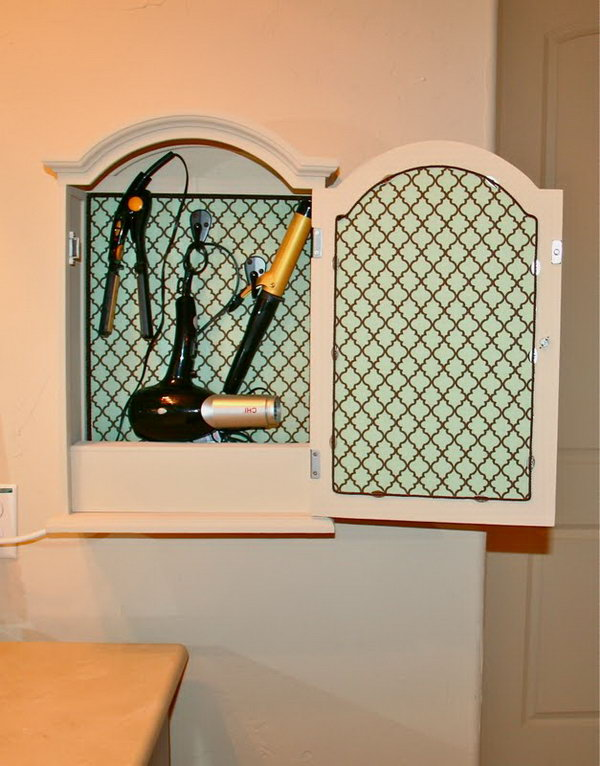 Mirrored Cabinet Storage. Convert a little mirrored medicine cabinet or jewelry cabinet into storage for hair dryer and curling irons. Add a little shelf in the bottom of the cabinet to hide all of the cords and power strip. http://hative.com/creative-hair-dryer-and-curling-iron-storage-ideas/