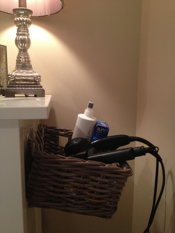 Organize Hair Dryer on Side of Dresser. Use 3M hooks and a basket to build a DIY hair dryer storage solution. http://hative.com/creative-hair-dryer-and-curling-iron-storage-ideas/