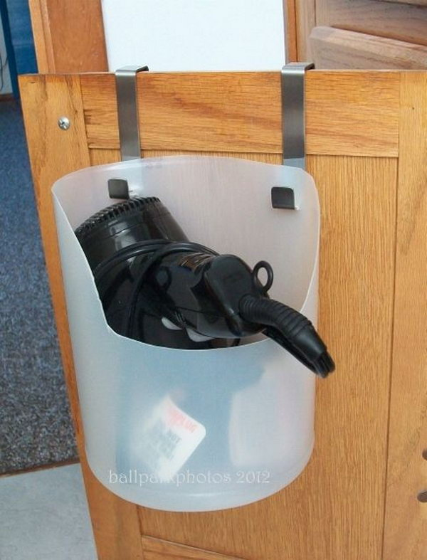 Hair Dryer Holder from Plastic Bottle. Recycle a used bleach bottle as a portable and inexpensive hair dryer caddy. Install it over lower cabinet door. Get the dryer and its clunky cord off your bathroom counter.