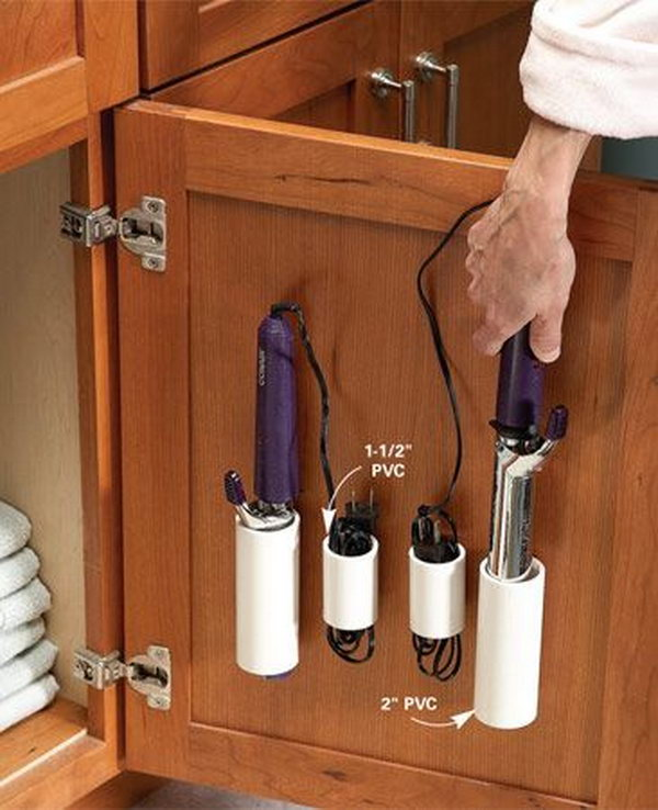 PVC pipe storage for curling irons and cords. Use the space over the vanity cabinet door for storage. Avoid the messy look of curling irons lying on the vanity or the toilet tank.