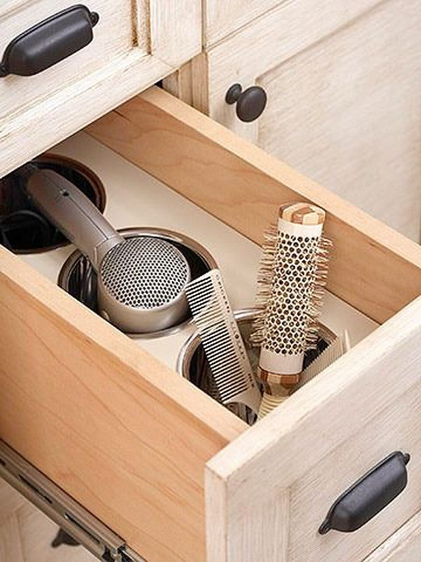 Bathroom Drawer Storage for with Compartments. Put a piece of wood and several bins in your bathroom drawer. Create extra space and keep your hair dryer organized.