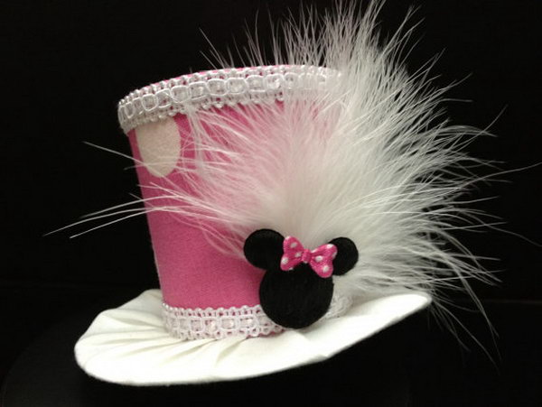 This adorable pink minnie mouse mini top hat is the perfect choice for your lovely daughter. White feathers are attached to the side along with cute Minnie Mouse head with pink polka dot bow to complete this adorable look! http://hative.com/cute-minnie-mouse-party-ideas-for-kids/
