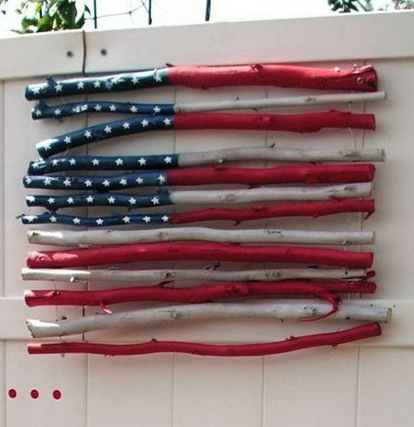 DIY Stick Flag. A cute idea to hang this twig flag on on front door for July 4th.