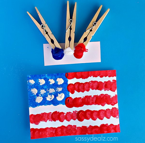 Pom Pom American Flag Painting Craft for Kids. Sometimes using a regular paintbrush can get boring so grab some clothespins and pom poms to make a cool American flag craft. This is fun and easy for kids to do on the 4th of July or Memorial Day.
