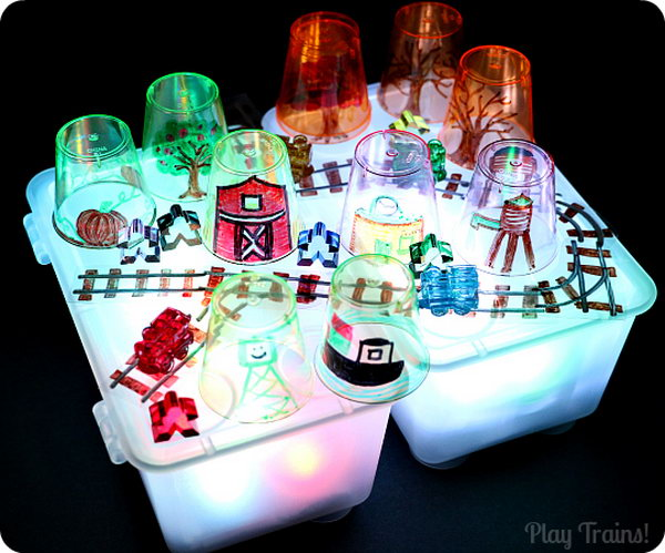 Story Cups for Light Play. What a fun idea for light table storytelling or pretend play.