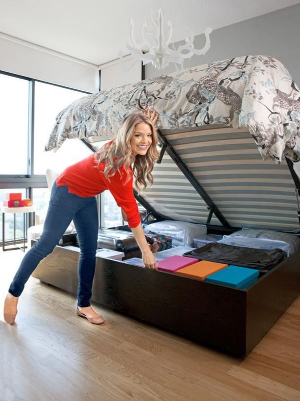 Secret Storage Under Hydraulic Bed. Use a hydraulic system to lift up the mattress easily to reveal additional storage space for your home. Keep plastic bins, suitcases and out of season stuff organized and out of sight.