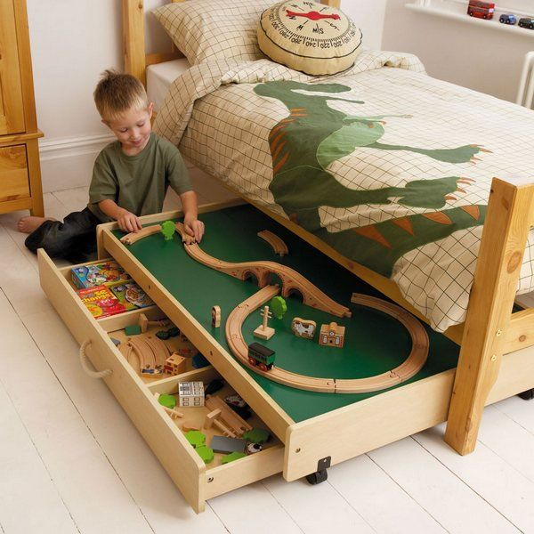 This play table under the bed not only provides a useful play area in your busy bedroom, but also reveals more storage space for toys.
