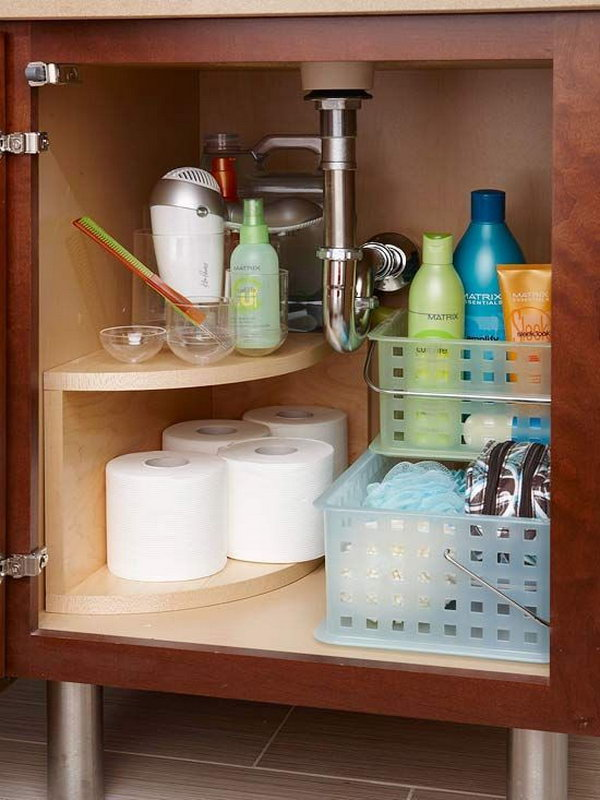 install a curved multitier storage unit along the undersink plumbing