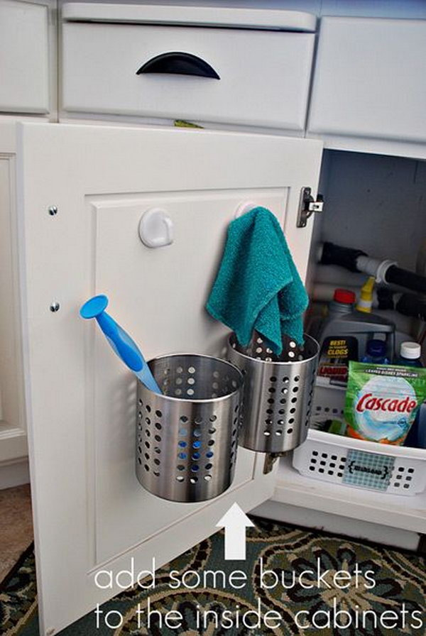 Buckets Over The Cabinet Door. Keep your sponges, brushes and pot scrapers sorted under the sink. Hide them out of sight while still giving them room to breathe and dry properly.