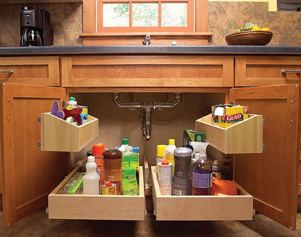 The storage space under the kitchen sink is usually dark and dingy. These roll out trays will get everything out in the open and let you find exactly what you need at a glance.
