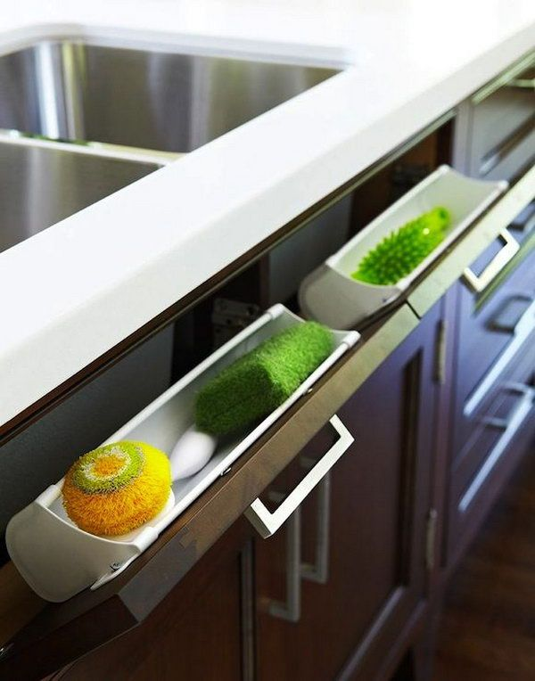 Under Kitchen Sink Storage. Use hidden pull out panel below kitchen sink to store sponges and accessories.