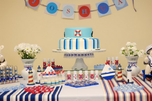 This very modern and clean nautical themed party is rich in details. The little decorations such as anchors, rudders, sailings and lighthouses are so cool.