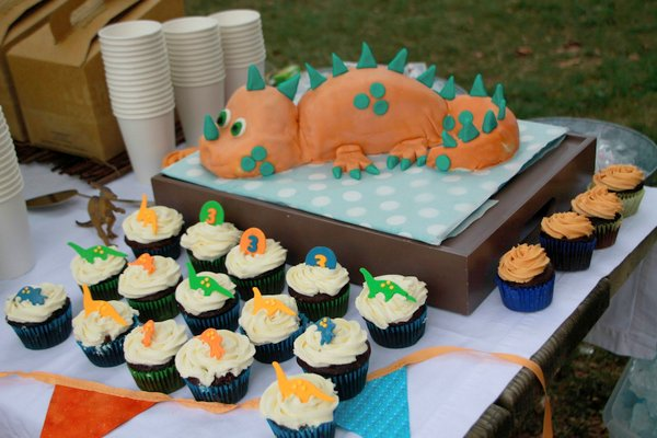 Dinosaur themed birthday party is absolutely a baby boy's favorite. The color scheme was orange, turquoise, apple green and brown — and there were dinosaurs everywhere!