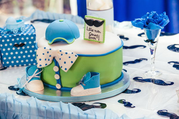 How cute is this little man mustache themed party! Look at the darling Little Man cake, all of the fabulous mustache banners and decor, the cute mustache table cover combined with a ruffled blue table cover, the cute favor bags with mustaches on them and MORE!