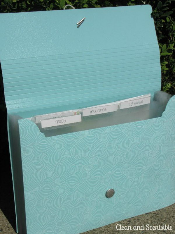 You can buy a file folder from a store and use it to keep your paperwork such as your maps, the proof of insurance, etc. organized and easy to find next time. The file folder can be stored in the glove compartment within reach for your convenience.