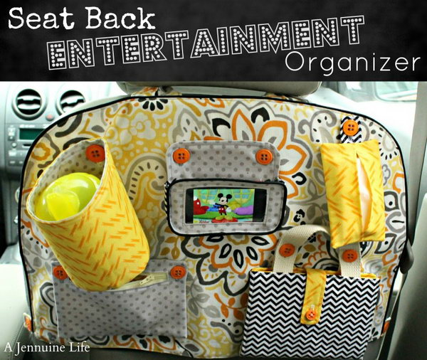 Seat Back Entertainment Organizer. This beautiful and cool seat back entertainment organizer is handmade with a drink holder, phone holster, tissue bag, zipper pouch, coloring folio. It is easy to make one for a good user of the sew machine.