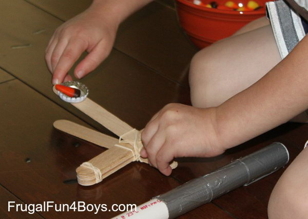Craft Stick Catapult. This is the best design for young kids.It is built with a bottle cap,which is definitely easier for little hands to shoot.