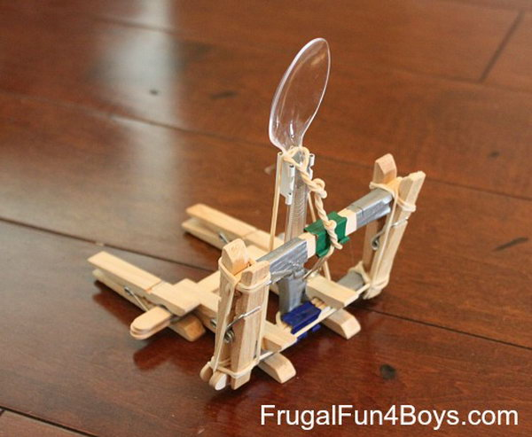 Siege Catapult. You need the materials like, clothes pins, craft sticks, binder clips, rubber bands, duct tape, and a plastic spoon to build this awesome catapult.