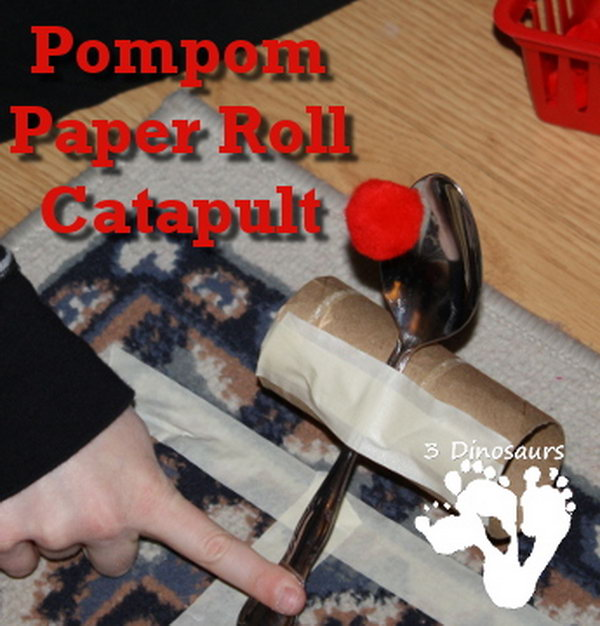 Pompom Paper Roll Catapult. To make this catapult is very easy. You can get the materials, like pompoms, a big spoon, paper roll, and masking tape around your house.