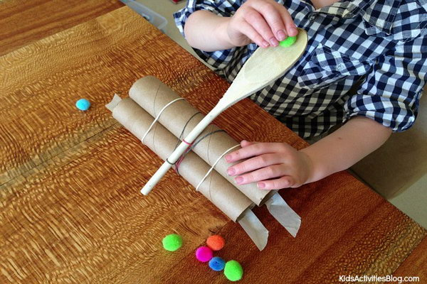 Wooden Spoon Catapult. Most kids love this catapult very much with a huge hit. It is enjoyable to watch the pom poms flying across the table. Parents and kids can PK to see who can launch their pom poms the furthest. Learn how to do it.