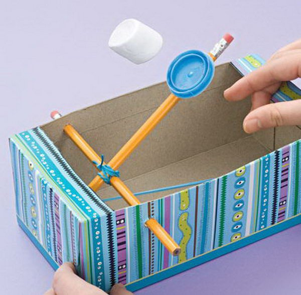 Recycled Shoe Box Catapults. Shoe boxes lying around your house are not just trash. Instead of just throwing them away, you can reuse them in fun crafts and convert them into a fun toy for you lovely kids just with 2 pencils, a rubber band, and a milk cap. Learn how to do it. http://hative.com/catapult-projects-for-kids/