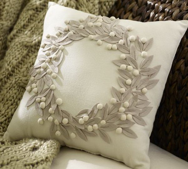 Pottery Barn Pillow Knockoff: I can hardly tell what pillow is from pottery barn and what pillow is handmade by you. Look at the felt leaves and white cotton balls, I really love the simple beauty of this pillow! See the tutorial