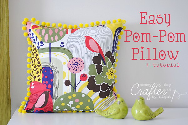 Easy Pom Pom Pillow: The fabric is so vibrant and the matching yellow pom poms around edge are a great touch. Learn how to do