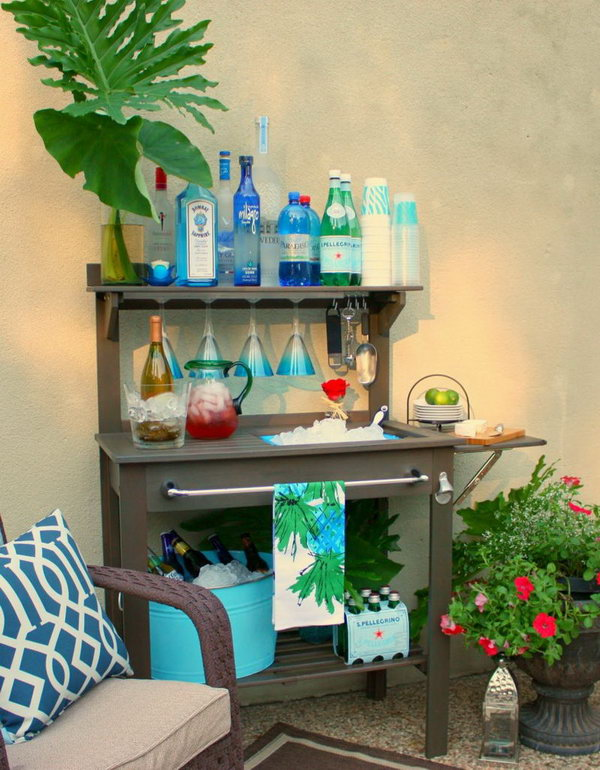 Potting Bench Drink Station. Display turquoise accessories to give this charming potting bench turned outdoor bar a summertime design. Drinks you serve on the terrace should be kept in a tight color scheme to create a harmonious visual effect.