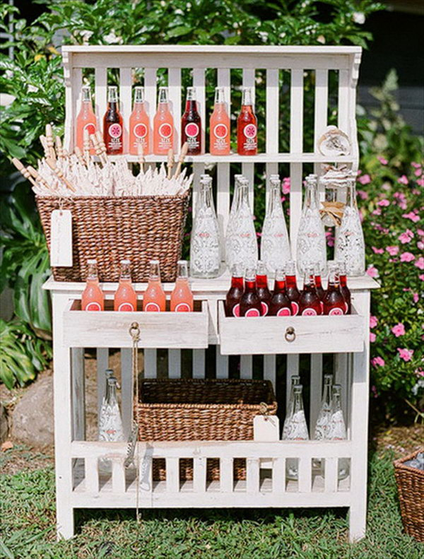 Bookshelf Drink Station. Serve your beverages in adorable glass bottles. Display them in good order in the bookshelf. This works perfect for a rustic style.