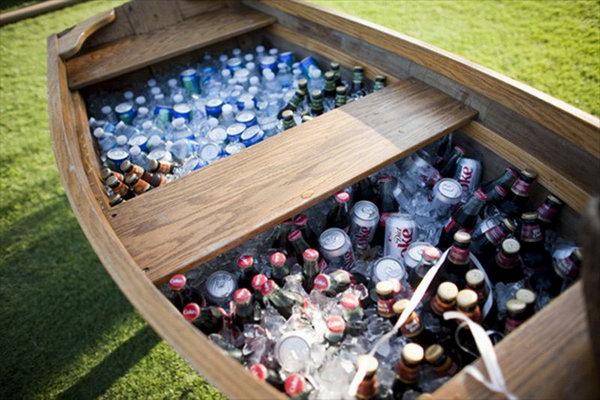 Mammoth Boat Drink Station. Rent a vintage boat and fill it with tons of ice and beverages to serve your guests for a gorgeous reception. This is also perfect for a rustic drink station design.