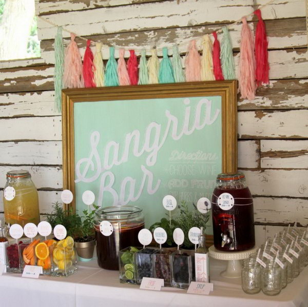 Sangria Drink Station. Beverage stations are a great way to offer tasty drinks besides the standard wine and juice to your guests. Add up a sign to draw attention to your sangria bar. The sign coordinates with the theme of this drink station perfectly.