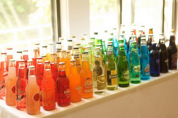 Classy Soda Bottle Drink Station. I really adore this beautiful and funny layout with a selection of soda bottles in bright colors. It's perfect to serve it to satisfy the taste of all ages.