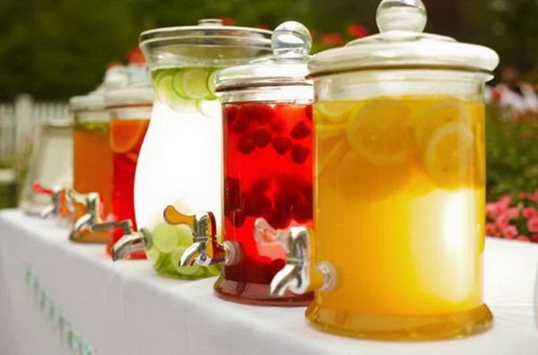 Clearly Cool Summer Drink Station. Bring into play the magic of clear jars en masse by filling them with jewel bright concoction of your style and matching fruit. Your guests will be impressed by this cool summer flavor with no doubt.