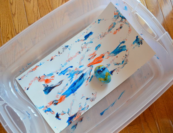 Artistic Easter Egg Roll. Place the colorfully painted Easter egg in a plastic box with paper taped at the bottom. Get the artistic  Easter egg roll painting by tipping the box in various directions.